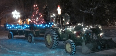 Tractor pulling Santa and Christmas tree